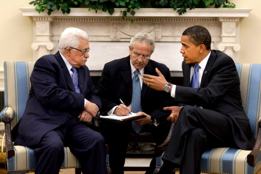 President Barack Obama meets with Palestinian Authority President Mahmoud Abbas in the Oval Office Thursday, May 28, 2009.  The man sitting between them is an interpreter. (  This official White House photograph is being made available for publication by news organizations and/or for personal use printing by the subject(s) of the photograph. The photograph may not be manipulated in any way or used in materials, advertisements, products, or promotions that in any way suggest approval or endorsement of the President, the First Family, or the White House.Official White House Photo by Pete Souza)